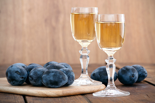 Plum brandy or schnapps with fresh and tasty plum