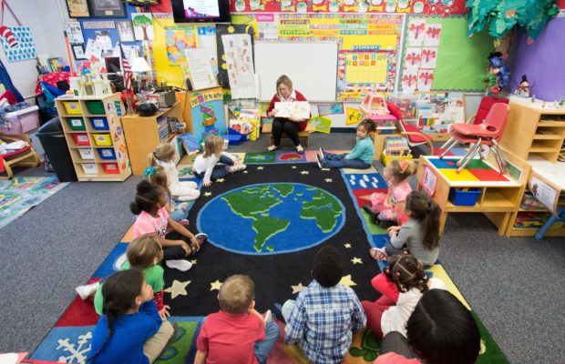 Keetsa McKeithen reads to her 3 year old class at T.R. Jackson Pre-K center Thursday February 11, 2016 in Milton, Florida. (Michael Spooneybarger/ CREO)